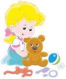 Little girl and Teddy bear Stock Images