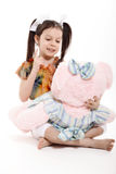Little Girl And Teddy Bear. On white background stock photos