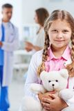 Little girl with teddy Stock Image