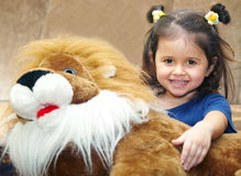 Little girl and teddy lion Stock Photo