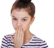 Little girl teenager closes her mouth Royalty Free Stock Photos