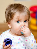 Little girl teething Royalty Free Stock Image