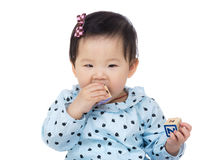Little girl with teething Royalty Free Stock Image