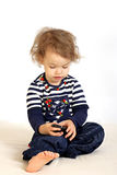 A little girl with telephone. A little girl studies a telephone and tries to call Stock Photography
