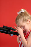 Little girl telescope Stock Photos