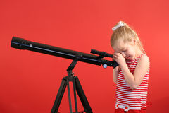 Little girl telescope Stock Image