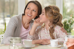 Little girl telling a secret Royalty Free Stock Images