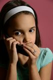 Little Girl telling Secrets on the Phone Stock Image