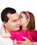Little girl telling something her smiling father isolated Royalty Free Stock Photography