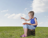Little girl telling a story, outdoors Royalty Free Stock Photography