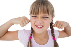 Little girl tensing her arm muscles Stock Photos