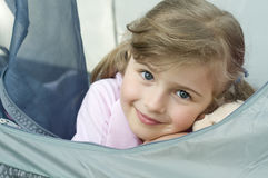 Little girl in tent Stock Images
