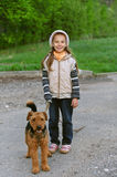 Little girl with terrier Royalty Free Stock Images