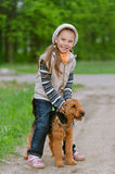 Little girl with terrier Royalty Free Stock Image