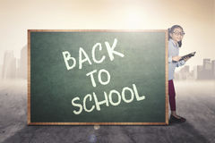 Little girl with text of back to school Royalty Free Stock Photo