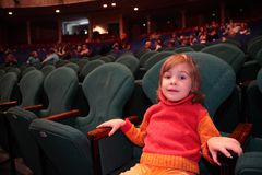 Little girl in theater Stock Images