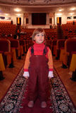 Little girl in theatrical hall Stock Photography