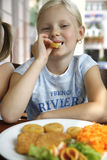 Little girl them lunch Royalty Free Stock Photo