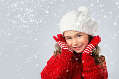 Little girl think about Santa on snow background Stock Images