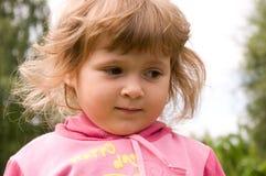 Little girl thinking Stock Image