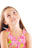 Little girl thinking. Little  blond girl with long hair thinking. White background Royalty Free Stock Photos