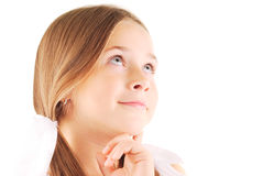 Little girl thinking. Little  blond girl with long hair thinking. White background Royalty Free Stock Image