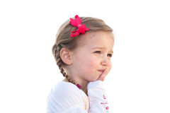 Little girl thinking Stock Images