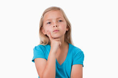Little girl thinking Royalty Free Stock Photos