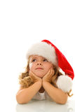 Little girl thinking about christmas Stock Photos