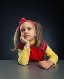 Little girl thinking Stock Photo