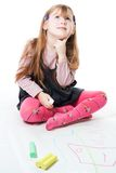LIttle girl thinking and drawing Stock Photos
