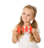 Little girl thinking of her family. Holding paper people - isolated royalty free stock photo