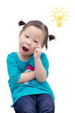 Little girl thinking with light bulb Royalty Free Stock Image