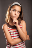 Little girl thinking Royalty Free Stock Images