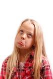 Little girl thinking sad thinks Stock Photo