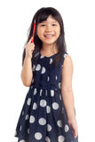 Little girl thinking with smile. And holding pencil isolated on white background Stock Photos