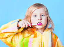 Little girl thinking while washing teeth Royalty Free Stock Photography
