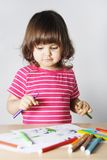 Little Girl Thinking What to Draw Stock Images