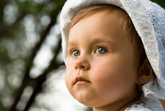 Little girl in thought. Closeup of adorable little girl in thought Stock Image