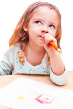 Little girl thought about drawing Stock Photography