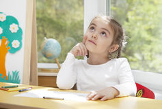 Little girl in thoughts Stock Photography