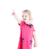 Little girl three years pointing at something Stock Photo