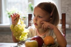 A little girl  with fruit Stock Images