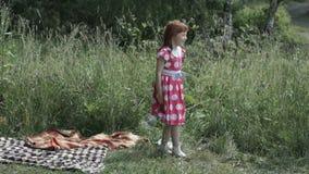 Little girl throwing ball away stock video footage