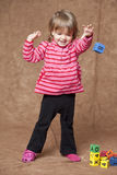 Little girl throwing block Royalty Free Stock Image