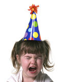 Little Girl Throwing a Tantrum. Child Throwing a Tantrum Wearing a Birthday Hat Stock Photography