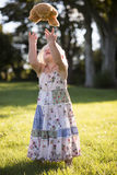 Little girl throwing teddy bear in the air Royalty Free Stock Images