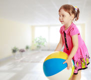 The little girl throws the ball Royalty Free Stock Image