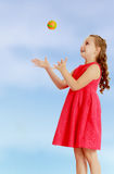 The little girl throws the ball up Royalty Free Stock Images