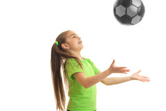 Little girl throws the ball up isolated on white background Stock Image